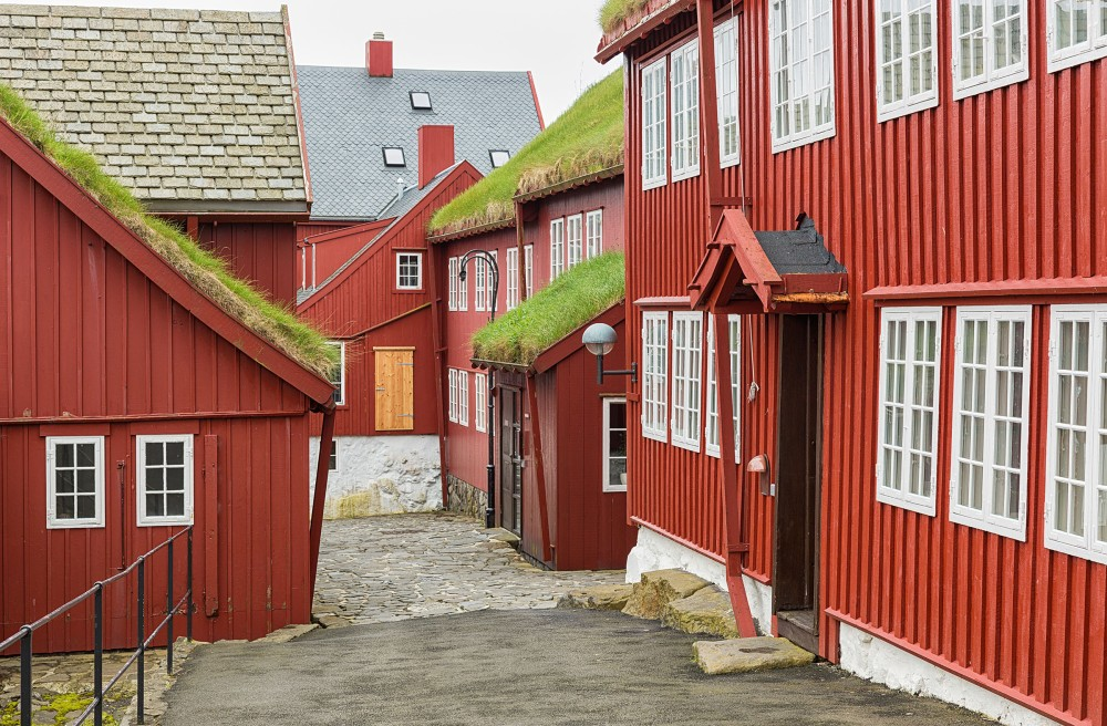 Main attractions include Tinganes, the oldest part of town, with small wooden houses covered in turf roofs.